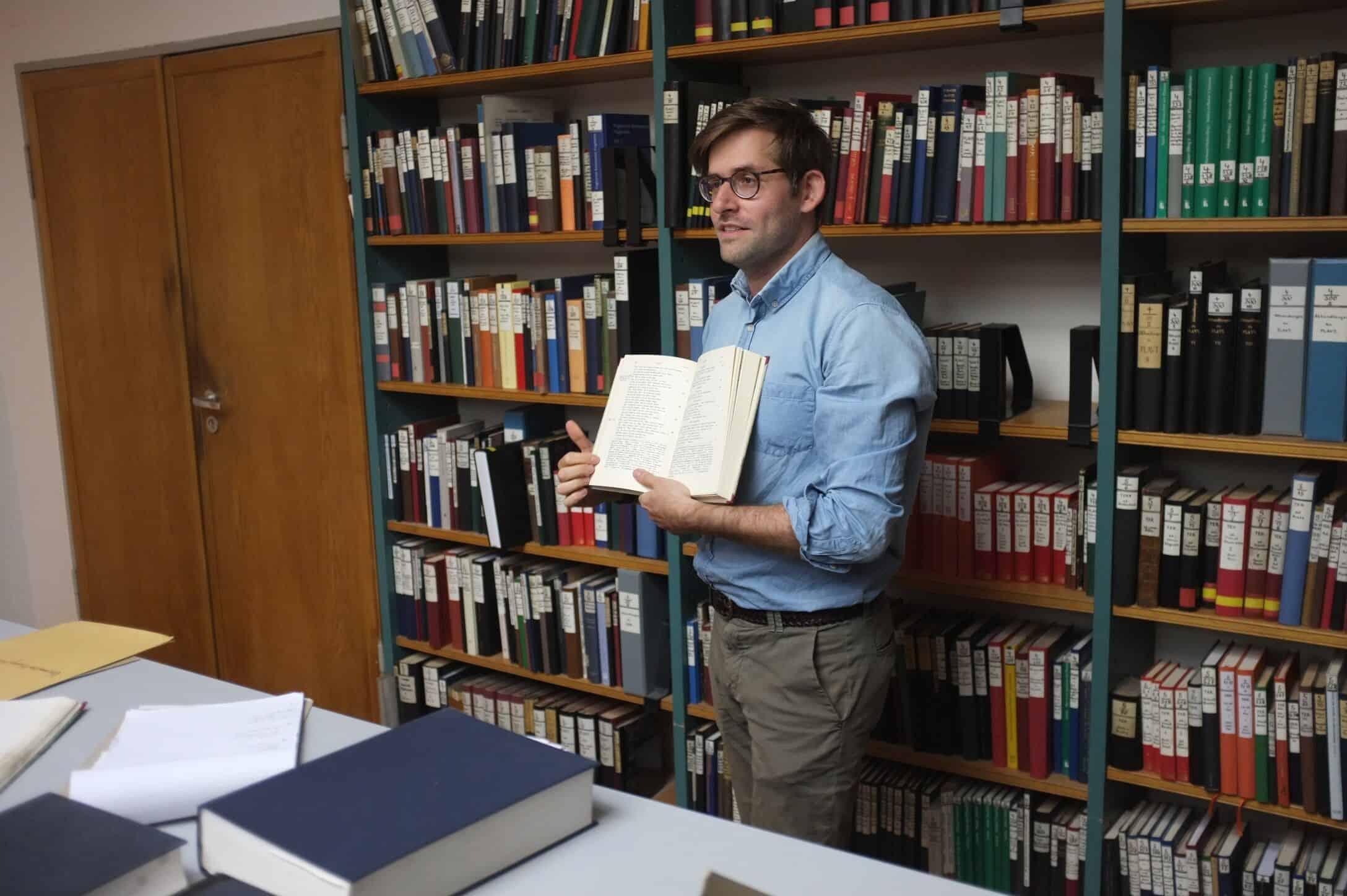 Adam Gitner in the library